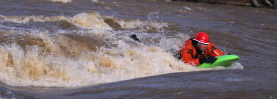 Photo: Spencer Cooke, Effort Inc - Adam Bellyak Surfs on the French Broad River