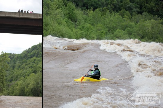 Onlookers enjoy the view while Eric crosses the top wave alongside river right.